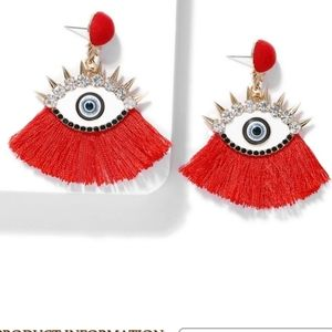 Fashion eye earings with stones and spikes